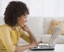 African woman looking at laptop Stock Photos