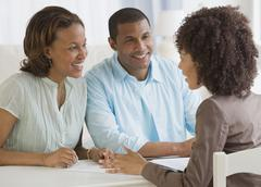 Stock Photo of African couple receiving financial consultation