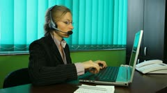 Pan of woman manager work call center hotline helpdesk agent at corporate office Stock Footage
