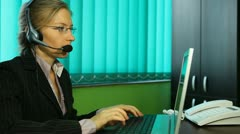 Pan of girl work at Call center hotline talking at earphones corporate helpdesk - stock footage