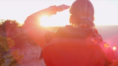 Lone female viewing sunset Stock Footage