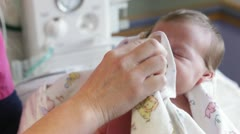 Newborn baby being cleaned near baby warmer Stock Footage