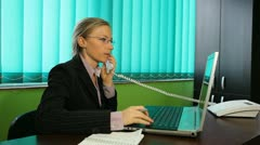 Businesswoman working at her desk, talking, phone, corporate, taping, callphone Stock Footage