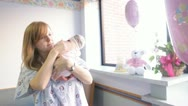 Mother burping newborn infant baby at hospital Stock Footage