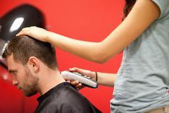 Male student having a haircut Stock Photos