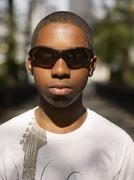 African teenage boy wearing sunglasses Stock Photos