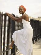 African woman leaning on railing Stock Photos