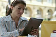 Happy young woman with tablet computer in cafe NTSC Stock Footage