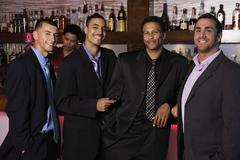 Group of multi-ethnic businessmen drinking in bar Stock Photos