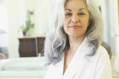 Stock Photo of Smiling woman wearing bathrobe in spa