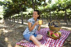 Hispanic woman having picnic in vineyard Stock Photos