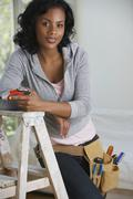 African woman with drill and toolbelt Stock Photos