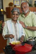 African couple making dinner Stock Photos
