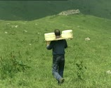 Stock Video Footage of CHEESE farmer carrying cheeses