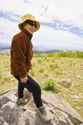 Japanese woman hiking in mountain terrain - stock photo
