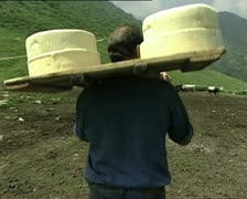 CHEESE farmer carrying cheeses close AUDIO - stock footage