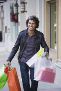 Middle Eastern man carrying shopping bags - stock photo