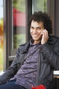 Middle Eastern man talking on cell phone - stock photo
