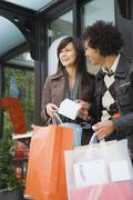 Couple with merchandise and shopping bags Stock Photos