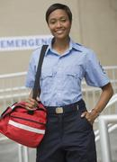 African paramedic holding first-aid kit Stock Photos