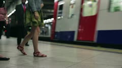 Subway train arives at London metro station HD Stock Footage