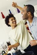 African couple cooking in kitchen Stock Photos