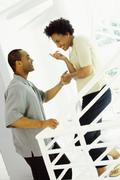 Stock Photo of African woman tempting husband upstairs