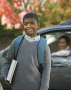 African mother dropping son off at school - stock photo