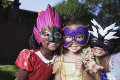 African girls wearing masks Stock Photos