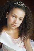 Mixed race girl wearing tiara Stock Photos