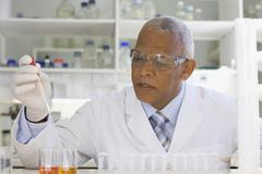 African scientist performing analysis in laboratory Stock Photos