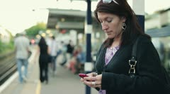Young woman using smartphone on train station HD - stock footage