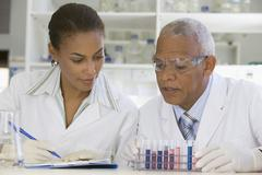 African scientists performing analysis in laboratory Stock Photos