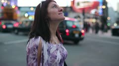 Young woman standing and looking around on Piccadilly Circus HD Stock Footage