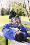 Hispanic businessman using PDA outdoors Stock Photos