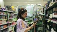 Young woman checking wine in supermarket, steadicam shot HD Stock Footage