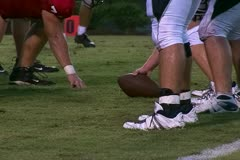 Football snap at line of scrimmage - stock footage