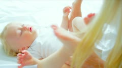 Blonde Mom Holding Young Child Stock Footage