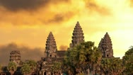 Stock Video Footage of Angkor Wat temple silhouette with sunset sky and clouds