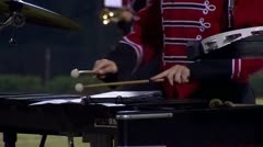 Band member at football game playing xylophone Stock Footage