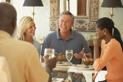 Friends eating at dinner party Stock Photos
