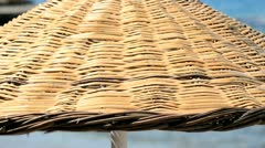 Wicker parasol on the beach Stock Footage