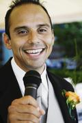 Russian man in tuxedo holding microphone Stock Photos