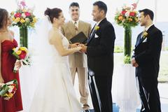 Multi-ethnic couple getting married Stock Photos