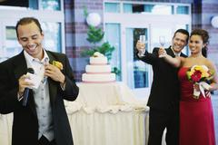 Russian man giving toast at wedding Stock Photos