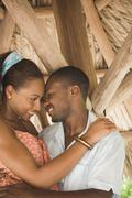 african american couple smiling at each other - stock photo