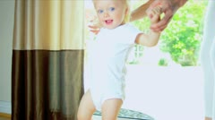 Young Child Taking First Steps Stock Footage