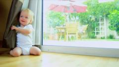 Caucasian Baby Hiding Behind Curtains Stock Footage