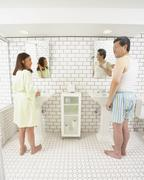 Asian husband and wife in bathroom together Stock Photos