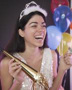 Latinalaisamerikkalainen nainen uudenvuodenaattona puolue Kuvituskuvat